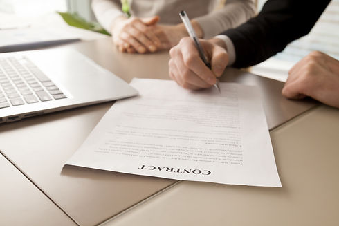 female-male-business-partners-signing-co