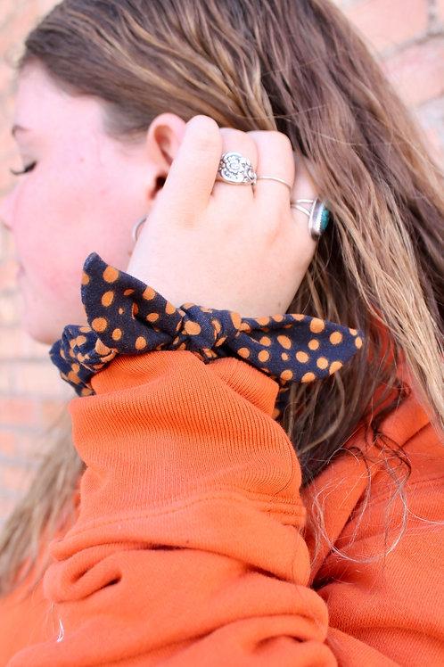 black spotted scrunchie
