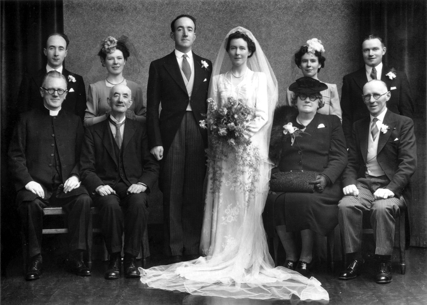 Standing (L to R): Philip Murray, Mairead O'Kane, Frank, Eileen, Josephine O'Kane, Gerald McGuinness Sitting (L to R): Rev. Joseph  Murphy, Charles Murray, Ellie O'Kane, Hugh O'Kane