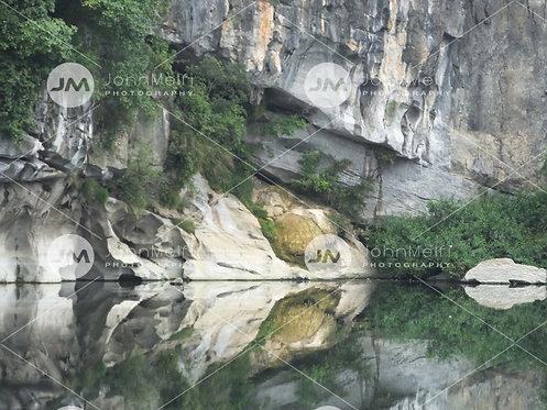 Skull Reflected on River