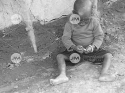 Maasai Boy Playing with Gift