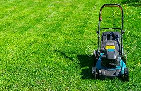 102685529-mowing-lawns-lawn-mower-on-gre