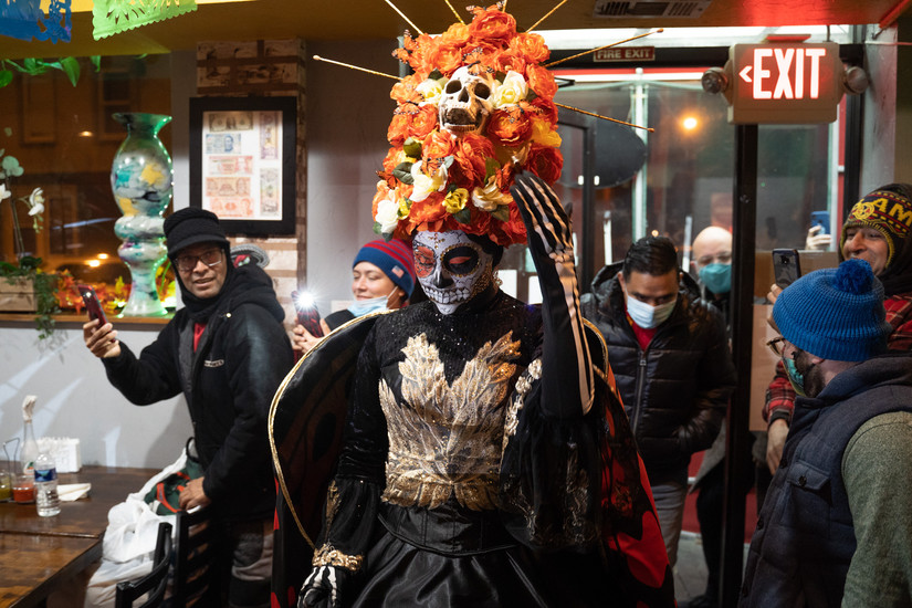 Rosa Ruiz enters the restaurant as La Catrina – one of the most recognizable figures of the Dia de los Muertos celebration. The women who dress up as La Catrina use the costume as an expression of how they view life and death.