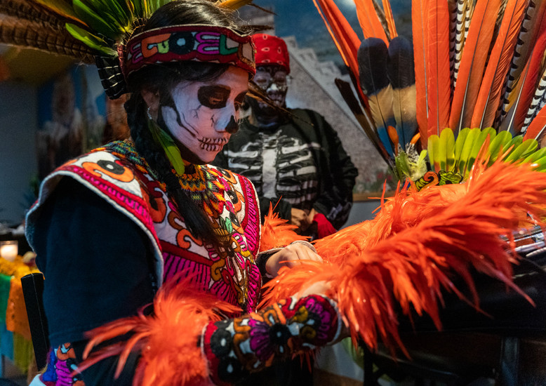 """Miranda Victoria readies her """"chinmalli"""" or ceremonial shield before the Dìa de los Muertos ceremony in South Philadelphia. At age 13, Victoria is the youngest performer in Philadelphia's large Aztec dance community."""
