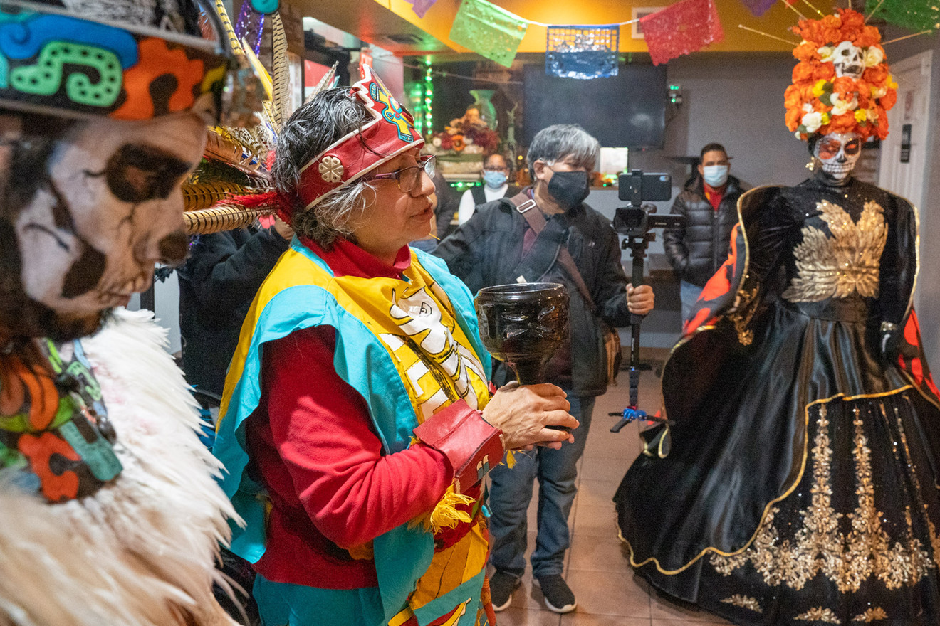 """Leticia Roa Nixon gives her """"La Palabra"""" or final words at the end of the ceremony, in which she gives thanks and pays her respects to those being honored on the altar."""