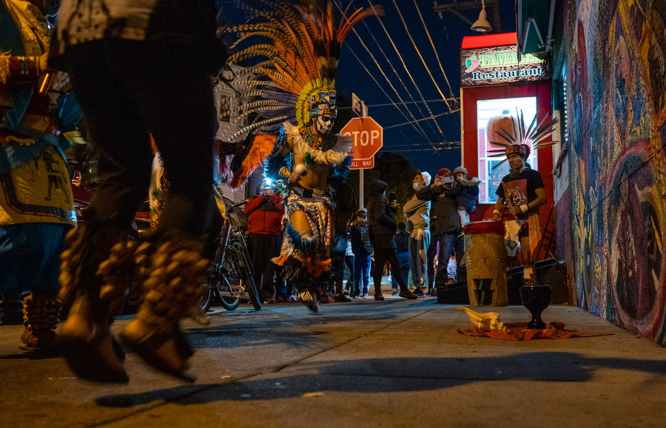 """The Aztec dance group perform """"Tonantzin"""" or the Earth dance outside Tamalex restaurant. The performance consists of four different dances honoring earth, wind, fire and water."""