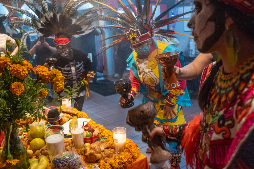 """Members of the Aztec dance group Kalpulli Kamaxtle Xiuhcoatl stir their """"sahumerios"""" or challices to produce smoke meant to purify the altar in Philadelphia"""