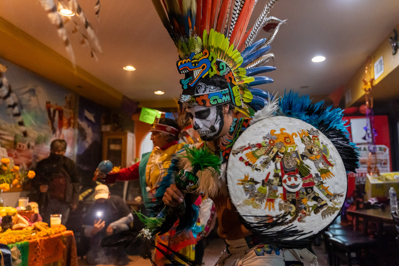 The symbols and figures found throughout each dancer's costume correlate to the astrological belief structure of the Aztec culture.