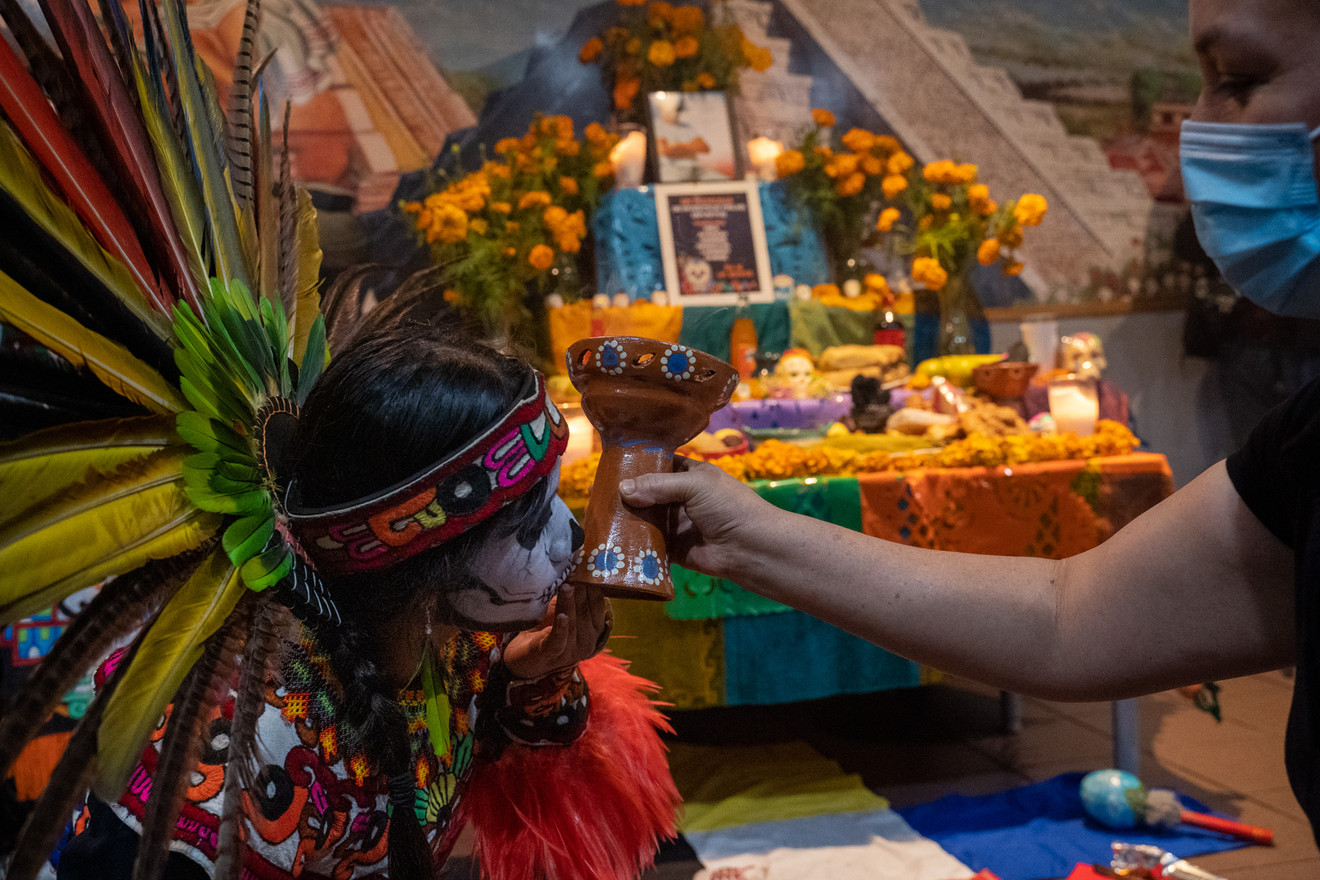 """Miranda Victoria kisses the """"sahumerio"""" or chalice, which carries incense meant to connect the participants of the ceremony to deities and the deceased family members being honored."""