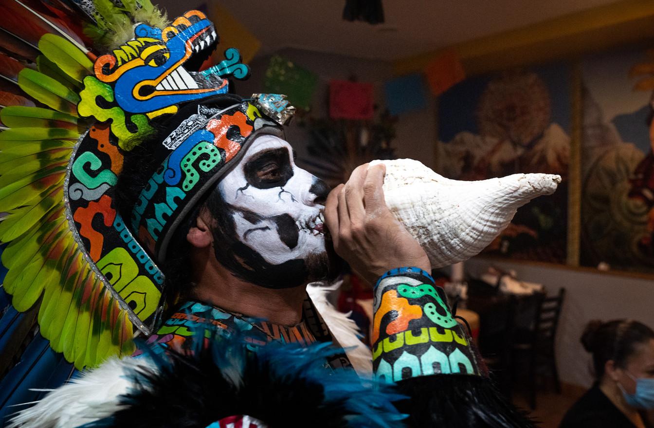 "Javier Maldonado blows into "" el atecocolli"" a ceremonial conk shell to initiate the ceremony. Santamaria founded the dance group Kalpulli Kamaxtle Xiuhcoatl six years ago"