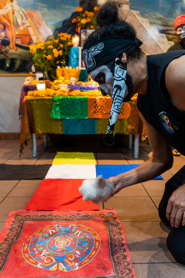"""The four directions on a compass are revered in Aztec culture. Group leader Javier Maldonado sets the altar by acknowledging east west north and south with the """"atecocolli"""" a ceremonial conk shell."""