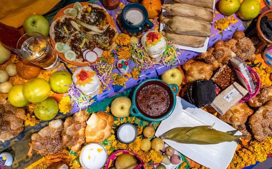 """The """"Ofrenda,""""  the traditional altar, is one of th most important elements of Dia de los Muertos. The food placed on altar reflects the favorites of those being honored in the ceremony."""