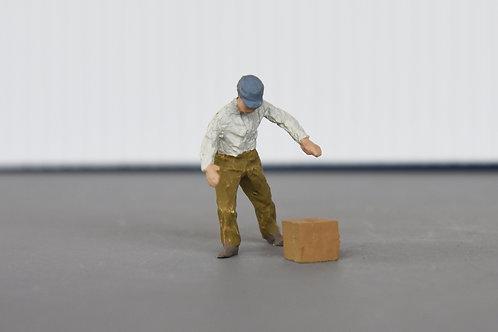 Man picking up box