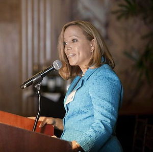 Tracy C. Lemmon speaking at a podium