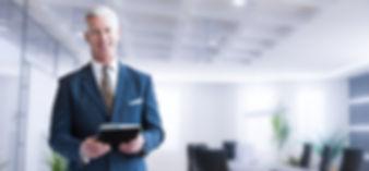 Portrait of senior businessman using tab