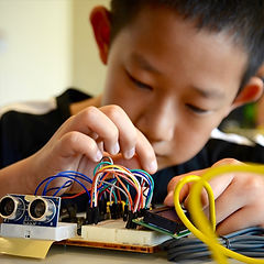 Kids in STEM Summer Camp working on electronics hacking projects