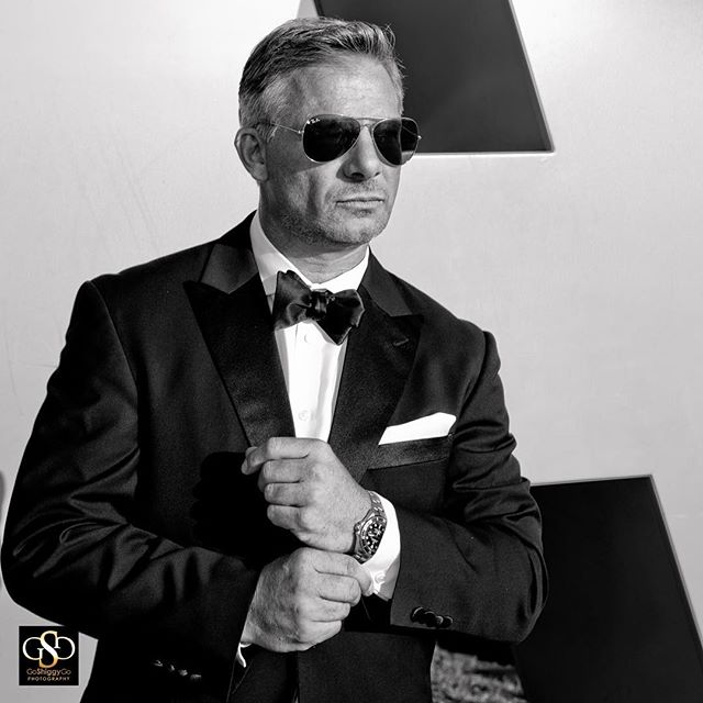 Bond. 007. AKA Shannon Diem sporting a tailored tux, Ray Bans, a Rolex and an attitude that is cool,