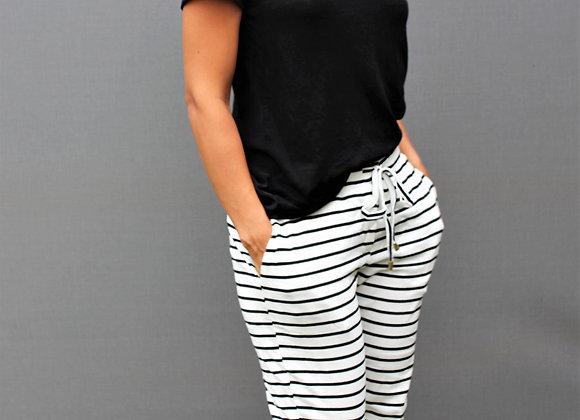 White slim leg joggers with black stripes