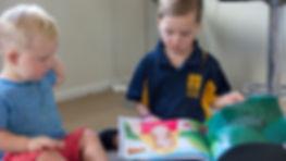 Children reading Ticklish Teeth book
