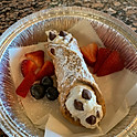 Chocolate Chip Cannoli topped with Strawberries & Blueberries