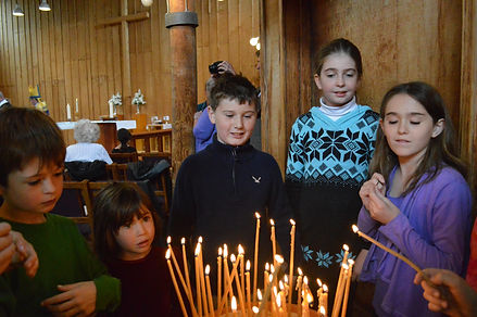 Kids lighting candles.JPG