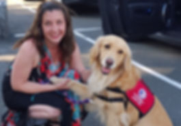 Positive reinforcement dog traine Elisa Rivera posing with Golden Retriever service dog at Bergin University of Canine Studies