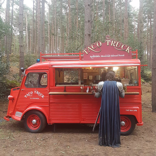 TACO TRUCK  IN A FOREST SERVING A KNIGHT