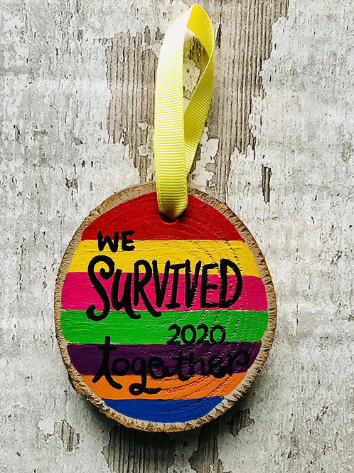 'we survived 2020 together' rainbow tree ornament