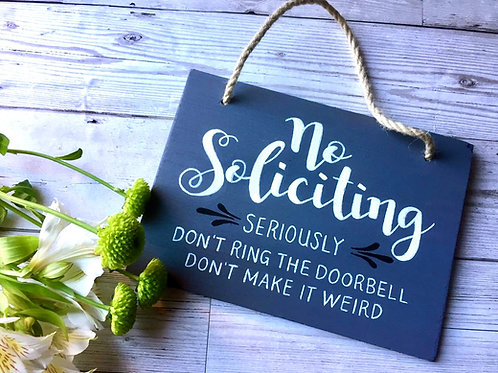'no soliciting' hanging sign