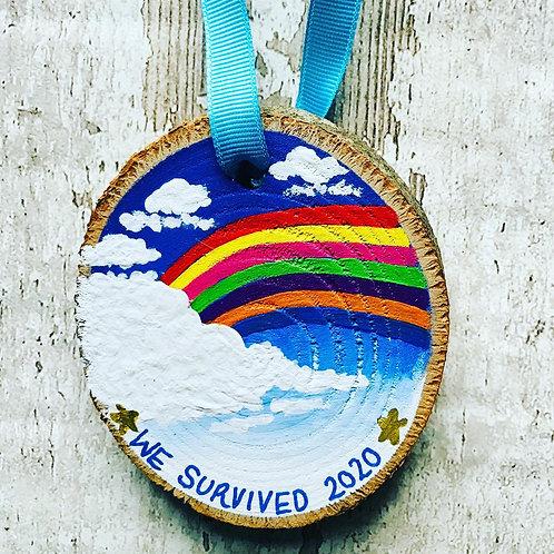 'we survived 2020' rainbow tree ornament