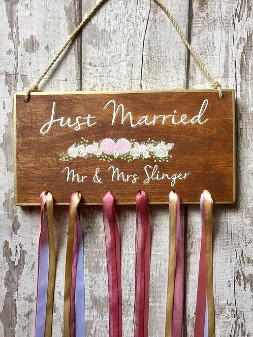 Hanging 'just married' car sign