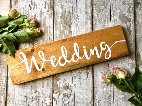 Rustic wooden 'wedding' sign