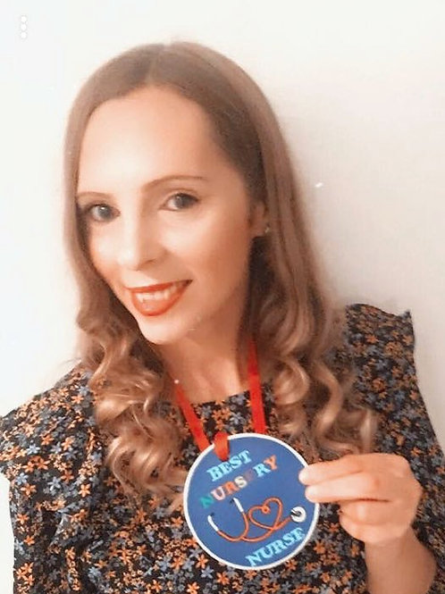 'Best nursery nurse'  wooden medallion
