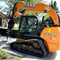 Bobcat driveway demolition by Chace Construction in Calgary, AB