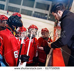 stock-photo-tactics-coach-in-game-hockey