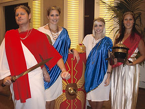 Sabre facilitators dressed in Roman gard for the team building game When in Rome