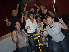 An all girl team building bikes for charity as part of Sabres Whose Bike Is This Anyway charity event