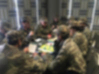 A mixed team competing in Sabre's 'Battlespace' team building business game