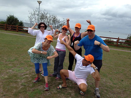 A team engaged in an Amazing race team building activity at Byron Bay