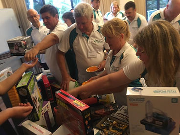 Teams compete to acquire and donate toys to a range of children's charities during Sabre's team building for charity events.