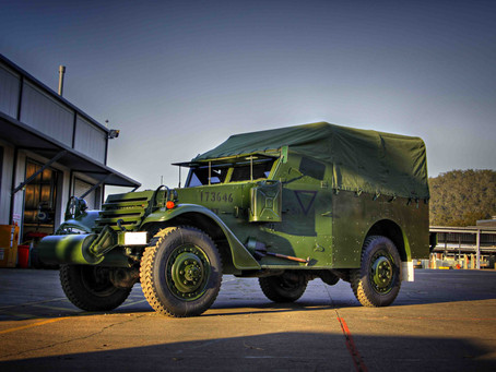 """Historic military vehicles arrive for team building with a """"business is war"""" theme."""