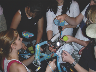 A team in action building a bike for charity at a Sabre team building event