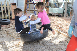 Playing in the tire swing