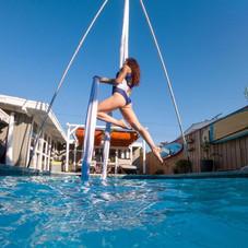Aerialist over pool