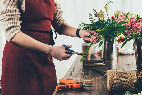 cropped image of florist cutting stalk o