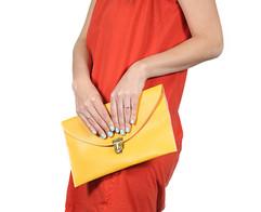 Woman holding yellow purse