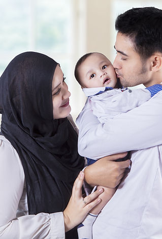Portrait of happy muslim family kiss the