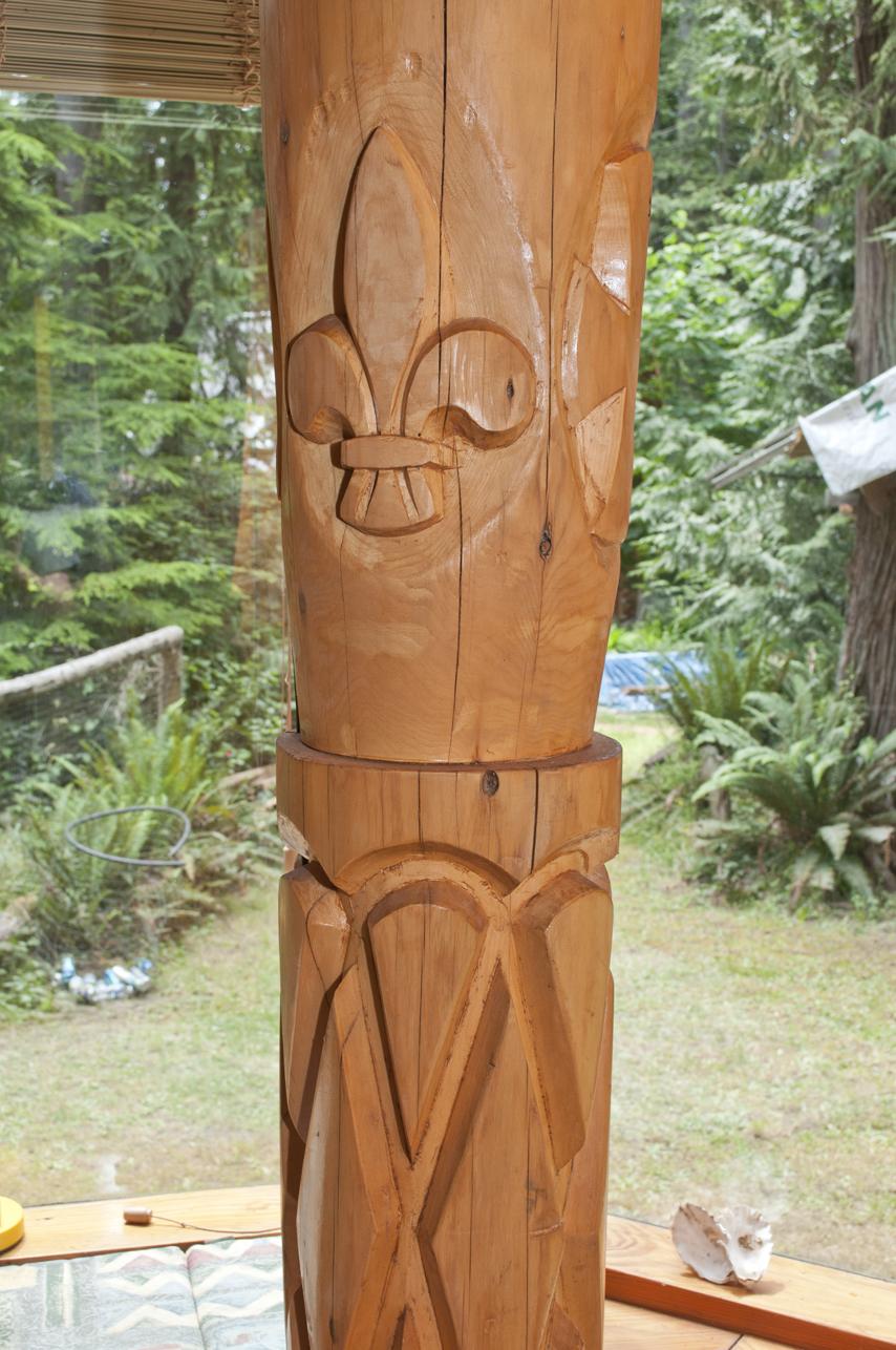 Hand carved fleur-de-lis