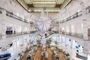 Joana Vasconcelos invades Le Bon Marché store in Paris with monumental embroidered creature 'Sim