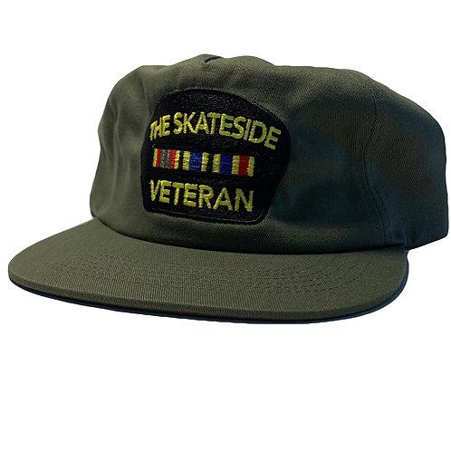 BLACK ON GREEN VETERAN HAT